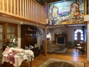 Linhay gallery with Julie's Quilt hanging.