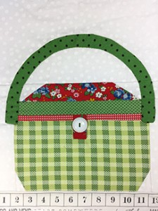 A GREEN SEWING BASKET web